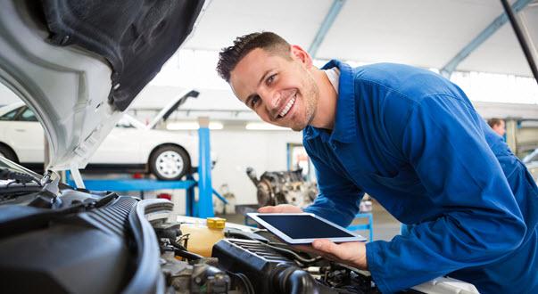Car Mechanic Checking Sensor Issues